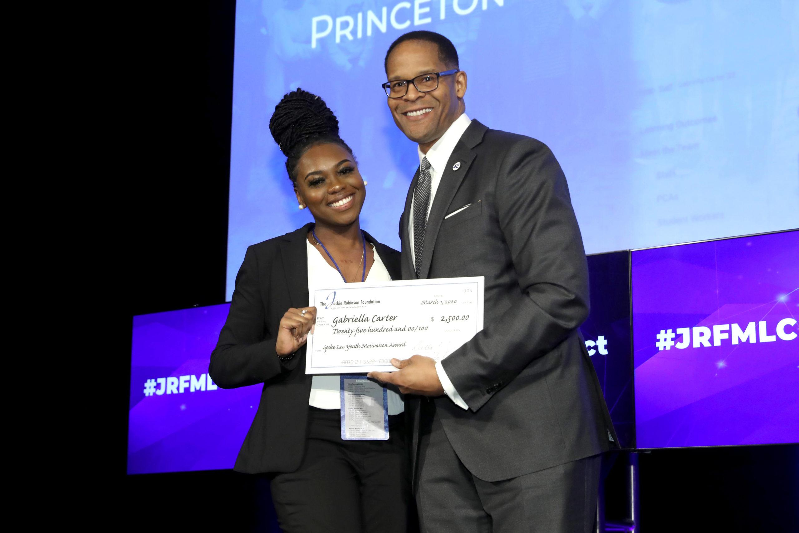 Gabriella Carter receiving award at MLC 2020 in New York City